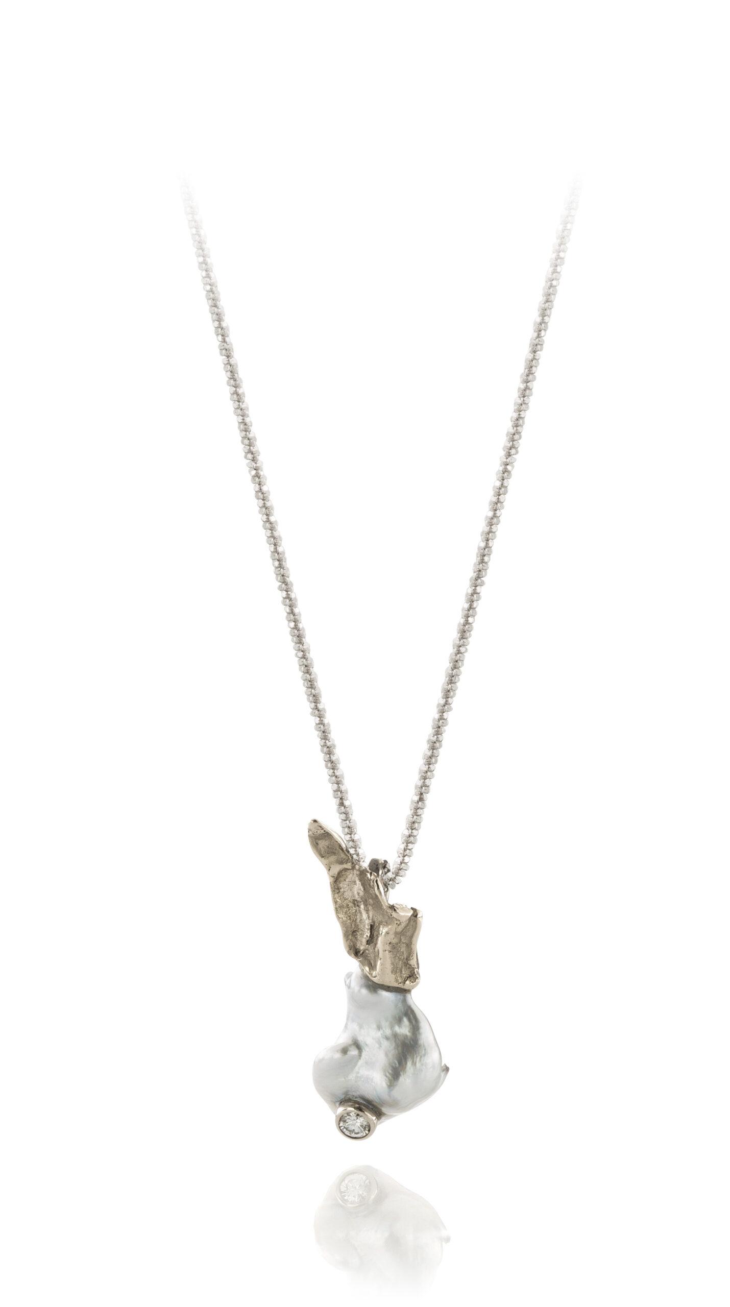 Wit gouden hanger 'visje' parel en diamant
